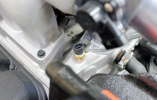 ECT sensors were commonly located in the front intake manifold coolant passage near the thermostat housing. This was convenient for cast-aluminum manifolds, but impossible for LSseries engines due to the intake manifold design. This Ram Jet 502 engine has an ECT sensor within the intake manifold front coolant passage. LT1 engines locate the ECT sensor in the front of the water pump. LS- series engines locate the ECT sensor in the bank 1 cylinder head.