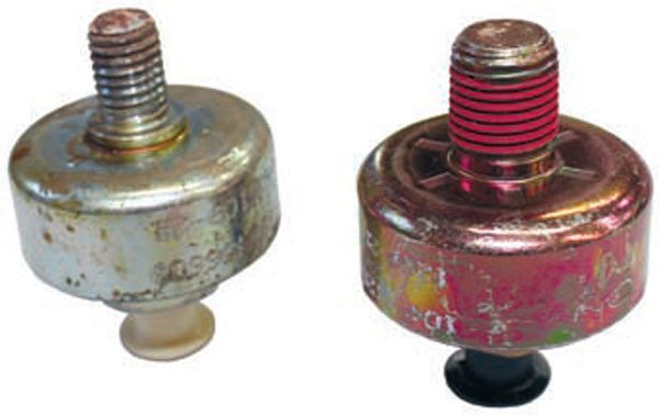 The LS-series resonant knock sensors (left) are installed in the intake manifold valley cover and use an M10x1.5 thread. The Gen I and Gen II small-block resonant knock sensor (right) is typically installed near the bottom of the engine block in one of the 1/4-inch, 18 NPT threaded coolant drain holes.