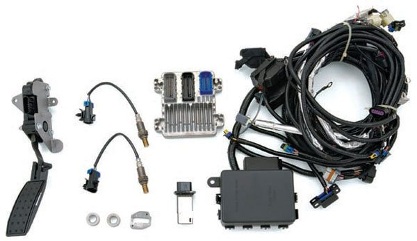 If you buy a used engine, the wiring harness, computers, and peripheral equipment are there for the taking. But if you buy a crate engine, this equipment may need to be purchased separately. This engine controller from Chevrolet Performance offers the best of both worlds: a factory-backed computer with performance tuning built in. (Photo Courtesy General Motors)