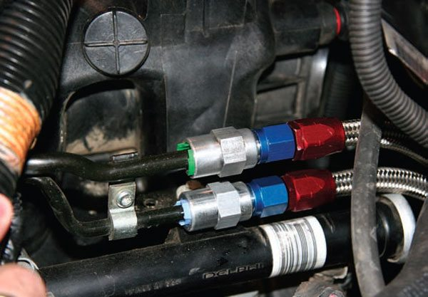 Stock fuel rails use a snap-on clip fitting, but these rails have been modified to accept AN-style fittings. (Photo Courtesy Street & Performance)