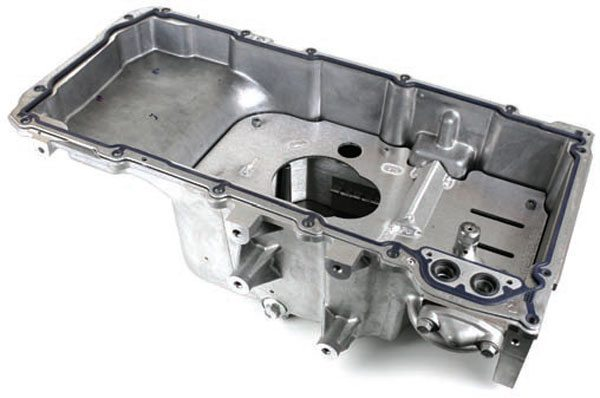 The 2010–up Camaro uses this oil pan for the LS3 and LSA engines. It has pro-visions for mounting an oil cooler. Its odd shape makes it a tricky pan for swappers. Improved Racing made the internal baffling in this pan. (Photo Courtesy Improved Racing)