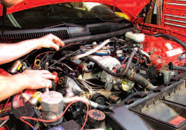 Reinstallation of your engine will take some time and care, but one bit of good news is that it shouldn't be nearly as messy as during removal, since you won't be draining any fluids! In addition to the wiring harness, exhaust piping, cooling system hoses, fuel lines, emissions hoses, and all other engine-related systems, be sure to reconnect any brake, power steering, and A/C lines you may have disconnected during engine removal.