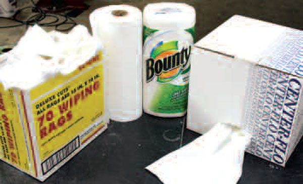 Shop rags and paper towels will do the dirty work of initial parts wiping, and you should have an ample supply of them. Final cleaning should be performed with lint-free cloth like these assembly wipes from Goodson (right). Not pictured here but also helpful are so-called shop towels, which are usually blue and are essentially a stronger type of paper towel.