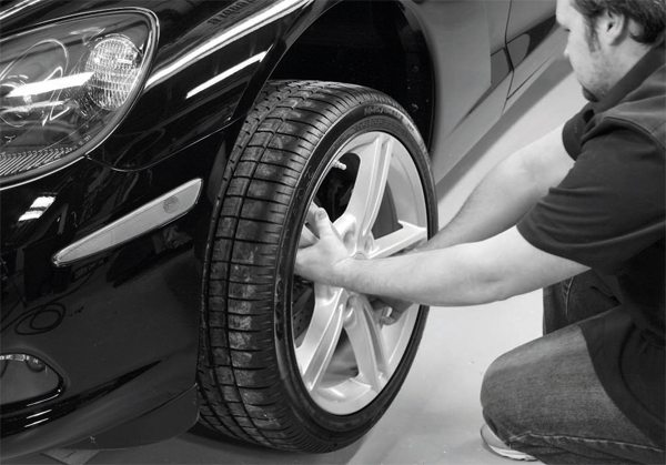 Removing the front fascia or bumper cover in order to install the intercooling system's heat exchanger, plumbing, and hardware typically requires the removal of the front tires in order to gain access to and adequate leverage on the fascia's fasteners.
