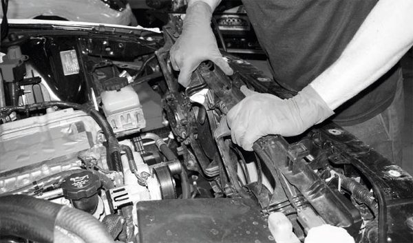 Next, the front of the engine compartment is readied for the chargecooling system. That process begins with the temporary removal of the electric cooling-fan assembly from the rear of the radiator. It is secured with a few easily accessed fasteners. The wiring harness must be disconnected, too.