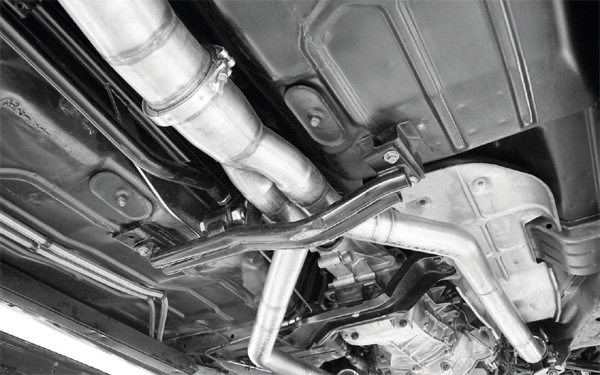 A high-flow, restriction-free exhaust system can reduce turbo lag, although street enthusiasts have to balance low restriction with legal sound compliance. Fortunately, turbo systems can mute some of the loudness of an engine, so there's more room to play with when it comes to implementing a free-flowing exhaust system that won't draw the ire of neighbors or the ticket books of police officers.