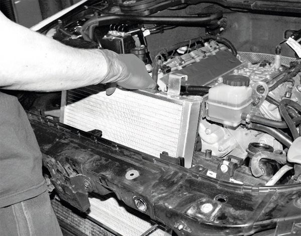 The heat exchanger for the G8 has brackets that hook on to the top of the radiator to hold it in place. In fact, adhesive-backed rubber pads are used for a tight fit at the top of the radiator and no bolts or other fasteners are used. This isn't the same for all LS vehicles, but holds true for many of them.