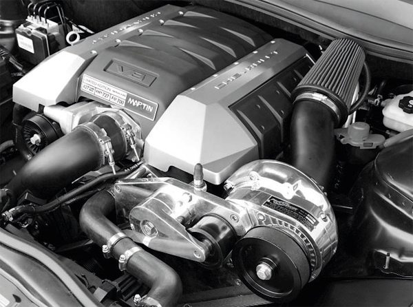 Here's a typical bolt-on ProCharger system on a fifth-generation Camaro SS. As with Vortech superchargers, ProCharger's larger compressors are mostly interchangeable with the bracketry, allowing custom combinations. Proper tuning is paramount when using a high-boost, large displacement compressor, as is the durability of factory engine parts.