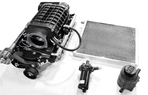 """The Eaton-based Magna Charger supercharger system is delivered ready to bolt on. In fact, the 1.9-liter supercharger was pre-mounted to the intake manifold, as seen here. The satin-black finish looks more """"O.E."""" than the typical baremetal finish of most blowers. The other primary components of the system include the heat exchanger, electric pump, and coolant reservoir for the charge-cooling system. It is a dedicated system, meaning it is separate from the engine's cooling system and maintains its own circuit of coolant (the same 50/50 mix of water and coolant typically used in engines)."""