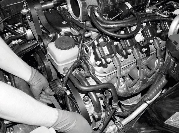 Next, the new serpentine belt is installed on the engine, including its routing on the supercharger pulley. One of the appreciated features of the Magna Charger kit is the integration of the supercharger pulley into the accessory drive system. Some systems may require separate belts and/or greater modification of the accessory drive components.
