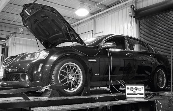 On Livernois Motorsports' dyno, the newly blown G8 put down 423 hp and 401 ft-lbs at the tires. It was a good result, but would have been even better with a less-restrictive cat-back exhaust system. Nevertheless, the car made more than 35-percent-greater power than when it entered the shop a few days earlier. Throttle response and overall drivability is excellent, too, with the blower's presence only heard and felt on demand.