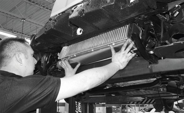 Next, the intercooler heat exchanger is mounted in front of the radiator. The procedure for the coolant circuit and hose routing for it is similar to the procedures outlined in the Magna Charger installation projecton page 60.