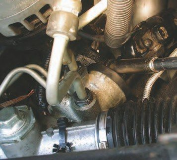 "15. Using a 7/16-inch socket, remove this bolt holding the intermediate steering shaft in place. The steering knuckle can be removed either here or at the lower point on the shaft. Removing it here is a better idea since it makes it easier to reinstall. Reinstalling it at the lower point on the shaft is also good because there are two flats on the shaft that make getting the steering back together with the steering wheel clocked in the ""right"" location a 50/50 proposition — you choose."