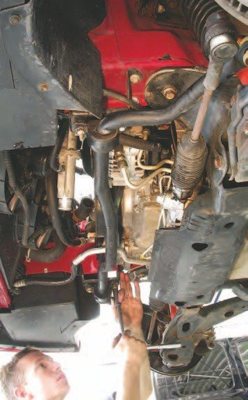 23. Release the front sway bar from the chassis by removing the four 13- mm bolts holding it in place. Let the sway bar hang on the engine cradle. A good way to keep from losing the bolts is to put them back in the mounts.
