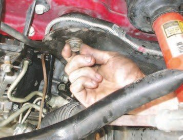 40. Remove the three 18-mm bolts from each side of the engine cradle (there is a total of six).
