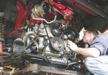 41. Now the engine should be completely unbolted and unplugged from the vehicle. You are now prepared to start raising the vehicle off the engine cradle. Do this an inch or so at a time, taking plenty of time to inspect for wires, hoses and other components that are hanging up on the vehicle, or that still might need to be removed.