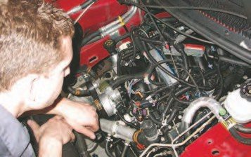 43. As you're separating the engine cradle and vehicle, be vigilant about making sure all of the wiring, hoses, and components are disconnected and clear from the vehicle.