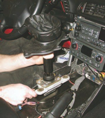 1. To lower the drivetrain out of a 'Vette you need to remove the shifter inside the vehicle. Getting the interior components removed to access the shifter is shown in the sidebar on the next page.