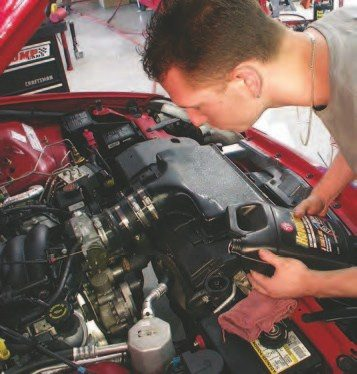 54. To reinstall the engine, just perform the steps listed here in reverse. After the engine is reinstalled, add oil and coolant. Be careful of air bubbles in the coolant system. It should take about 2.5 gallons of coolant/water mix, but this will probably need to be added a little at a time. The best way is to fill the radiator, then run the engine with the heat on full blast for a few minutes. The coolant level in the radiator should drop; then shut off the engine and add more. If the engine runs hot and doesn't take the coolant needed, it probably has a bubble at the thermostat. To fix this, open the system at the upper radiator hose (make sure the system is not under pressure), allow air to escape, and reinstall. Resume coolant filling.