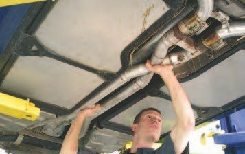 3. The first step is to remove the exhaust components that go over the rear independent suspension (see tip in next caption). Then, remove the exhaust tubes that run down inside the main spar tunnel as shown. As a tip, disconnect the O2 sensor connectors before removing the exhaust tubes.