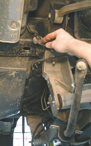 17. Disconnect the main wiring connector at the rear of the vehicle. This wiring is for the lighting and other electrical components at the rear of the vehicle.