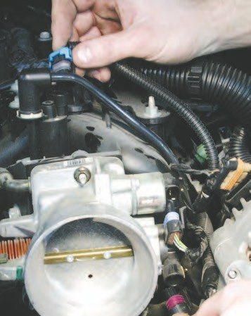 15. Next, remove the air temperature sender and EVAP solenoid control wire connectors (in hand). Notice the EVAP is removed. To do this, squeeze the connector while lightly pulling up to release it.