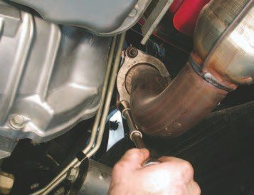 37. Next, unbolt the three 15-mm fasteners from the exhaust collector that connects the manifold to the exhaust Ypipe. To make this job easier, use a long extension to access these fasteners.