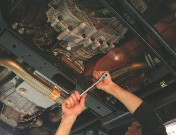 40. One of the methods to reach the top bolts on the transmission is to use a loooonnnnngggg extension on a ratchet. In this case, the torque required to loosen the bolts was too much, so we decided to remove the intake to access the bolts and connectors at the back of the engine (oil pressure, knock sensors, etc.).