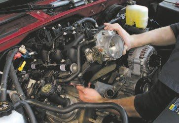 41. To get the intake off, you'll need to loosen the 10 nested 8-mm bolts and a few hoses and electrical connectors. The intake gaskets are a one-piece component, and it usually takes just a few pries on the intake-to-cylinderhead mounting flange to release the intake. Carefully vacuum around the intake before you remove it to avoid trash from falling into the intake ports.