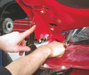 45. You'll need to remove the hood to get the engine out. To make it easier to reinstall, remove these two 13-mm bolts. This way, you won't have to realign the hood on the vehicle when you go to put it back together. Use two people to lift the hood off the vehicle because it's big and heavy.