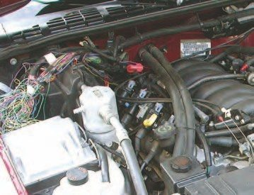 As can be seen by the wiring rat's nest in the engine bay, wiring up the Gen III so that it works in concert with the rest of the vehicle's controls is a challenge. If you're not electronically minded, find someone who is, or plan on buying an aftermarket wiring harness. Also, the calibration will need some work to run the S10 dashboard and other components, but these challenges are surmountable. Once this owner got through these details, this truck ran like a new hot-rod from the get-go.