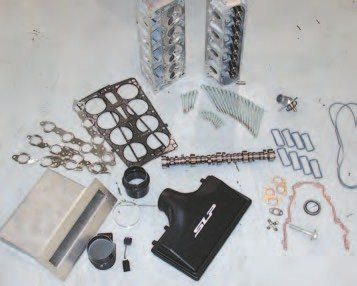 The components used for this upgrade come from SLP (www.slponline.com). The SLP components used here include assembled CNC-ported cylinder heads, a special roller camshaft, LS6-style intake, roller timing chain, 160-degree thermostat, MAF sensor, cold-air box for the vehicle, various single-use gaskets and fasteners, along with longtube exhaust headers (a few components not shown). All the aluminum- reinforced gaskets and seals required in the process of replacing these hard parts are available from GM or SLP. Also, SLP offers a calibration to go with these components. It needs to be flashed into the vehicle's PCM to take full advantage of the potential of this package.