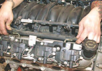 1. The LS-1 V-8 engine has very few hoses on its exterior, but the few that are left once an engine is removed from a vehicle will need to be pulled off the intake. This Gen III V-8 is an '01 LS1, but the entire Gen III engine family is similar except for a few hoses, wires, and sensors, so most of this info will apply to any Gen III V-8. You can easily remove these PCV hoses that connect the valve covers by pulling them off the valve cover vent tubes by hand.