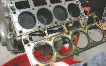 35. There are two different head gaskets used on the Gen III V-8. The 1997- '98 Gen IIIs used a head gasket that can be used on all Gen IIIs, but many hot-rodders believe it cannot withstand the same abuse as the 1999- and-later head gasket. The early head gasket can be identified because it has a cutout at the lower edge between 1 and 3 or 5 and 7 (depending on what bank you're talking about) on the lower edge. An important caveat here is the later head gasket cannot be used on the 1997-'98 head. Using this later gasket on older Gen IIIs will result in a substantial water leak — so make sure you get the right head gasket for your application.