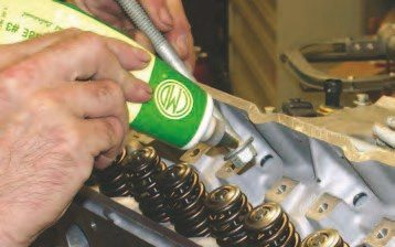 2. As in the case of the other critical fasteners, apply grease under heads of the cylinder-head fasteners.