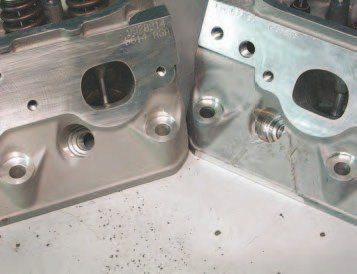 "If you are looking for used LS6 heads, the easiest way to identify them by a visual inspection is by the exhaust ports. The stock LS1 heads have oval exhaust ports, while the LS6 heads have ""D""- shaped port exits. The head on the right with the ""triangle"" casting mark is more desireable because it is the semi-permament mold casting — these consistently make 5-7 horsepower more than the sand cast head at the left."