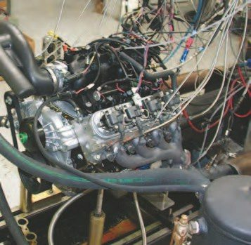 The 5.3-liter testing was performed on an engine out of an '01 SUV. The stock air cleaner, intake tube, and full exhaust were bolted up to the engine on the dyno.