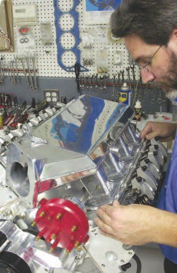 4. The W2W aluminum intake manifold was polished to a mirror finish by Gary Lentz and bolted to the cylinder heads. The intake is O-ringed, so no gasket or sealer is necessary.