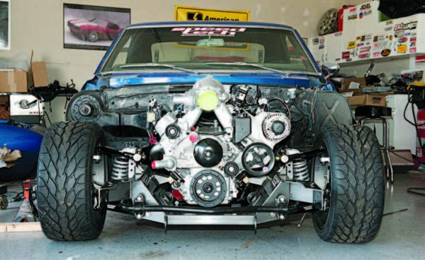 The engine/transmission assembly on top of the new subframe has been fitted to the body. Now, the new LS engine has been installed in my old-school muscle car