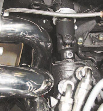 When planning any build, you may run into a problem like this where the header touches something it's not supposed to. In this case, you have a few options: You can dimple the headers, replace them, or swap in a newer and smaller steering box. If you have a manual steering box, you will not have any issues with clearance. However, I've seen a 50/50 ratio of cars that have clearance problems with the power steering unit. This just proves once again that using a system of complementary parts removes most of the guesswork. (Photo Courtesy Ryan Barichello)