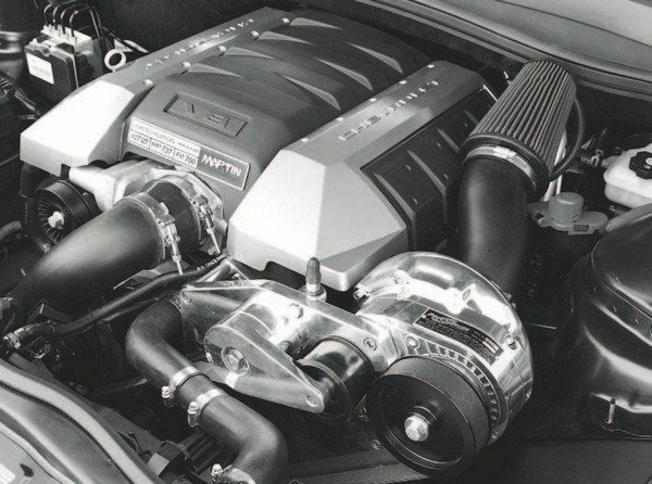 Here's a typical bolt-on ProCharger system on a fifth-generation Camaro SS. As with Vortech superchargers, ProCharger's larger compressors are mostly interchangeable with the bracketry, allowing custom combinations. Proper tuning is paramount when using a high-boost, largedisplacement compressor, as is the durability of factory engine parts.
