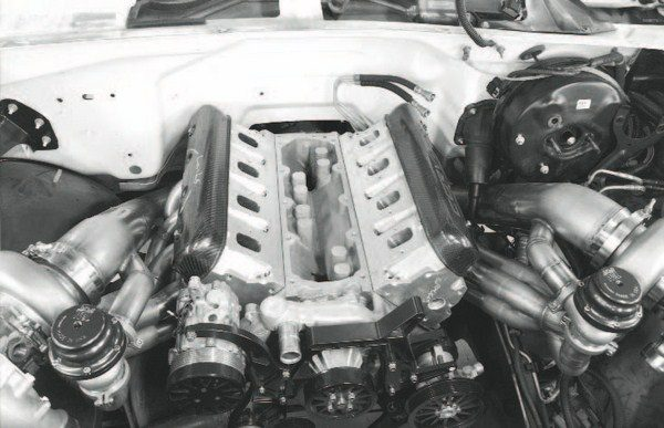On a streetdriven vehicle, a number of inescapable details affect the design and implementation of a custom turbo system. Here, routing of the large-diameter down tube from a remotely mounted turbocharger reveals some obvious interference issues with the vehicle's brake master cylinder. A smaller-diameter tube or one with another bend in it will likely make enough room for the master cylinder, but may cause a restriction that increases turbo lag.