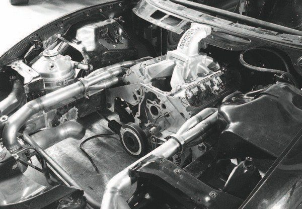 When the turbochargers are too large to mount directly to the manifolds on the engine, they typically end up mounted in the engine compartment. That requires a completely custom-fitted exhaust system to feed the turbine and carry away the exhaust via the down tubes. Because the turbos are located away from the exhaust manifolds, the manifolds themselves don't need to be cast iron. Here, a custom turbo exhaust system is being tacked together from conventional exhaust tubing. Such work adds complexity and cost to a turbo system.