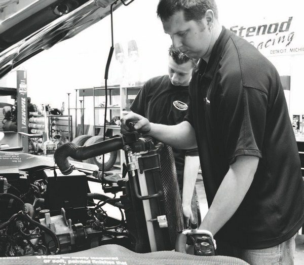 If a blower or turbo kit's instructions call for draining the coolant, it may be ultimately easier to remove the radiator as well for added clearance when pinning the crankshaft. It's also a necessary step when performing a camshaft swap in the vehicle.