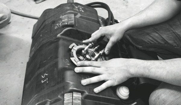 Replacing the in-tank fuel pump on most LS-powered vehicles requires the removal of the fuel tank, as the access hole is located on the top of the tank. Brass tools should be used when loosening or tightening the lock ring on the fastener, to prevent accidental sparks near the gas fumes.