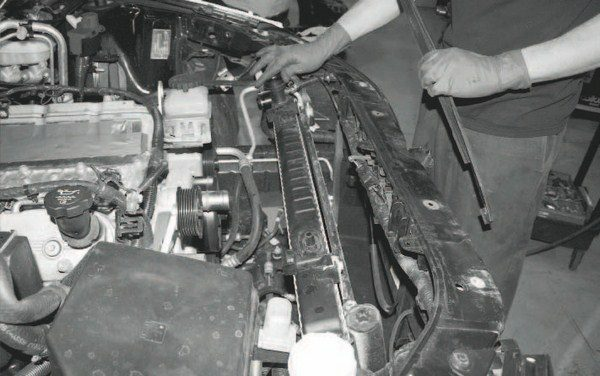 Although the installation procedure varies among vehicles, the chargecooler heat exchanger always mounts in front of the radiator. In the case of this project G8 GT, installation requires disconnecting the radiator (including the removal of the radiator hoses and draining of the coolant) in order to push it back a few inches to slip the heat exchanger in front of it.