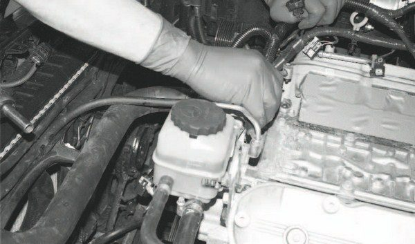 This application (along with most similar Roots/screw-type systems) requires a different cylinder-headcoolant crossover vent tube to accommodate the supercharger and new intake manifold. It is easily swapped with the help of a 10-mm socket, because the original intake manifold is out of the way. There are O-ring seals on both ends of the vent tube that must be transferred to the new tube.