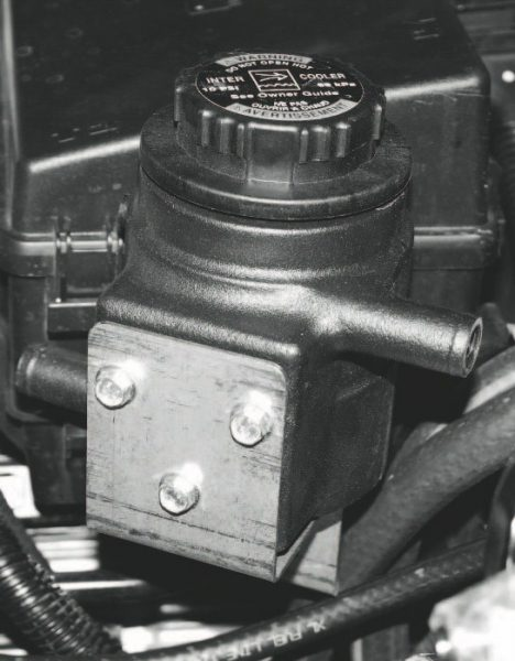 The charge-cooling system also includes a coolant reservoir. Mounting positions vary from vehicle to vehicle, but they are typically mounted higher in the engine compartment, while providing easy access to the fill cap.