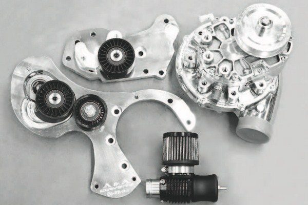 Here are the basic components of a centrifugal system, minus the intercooler hardware. The mounting brackets hang the supercharger on the front of the engine. This kit (from A&A Corvette) includes a large blowoff valve (at bottom of photo), which is a necessary accessory for preventing excess boost from being forced into the engine when the throttle is closed.
