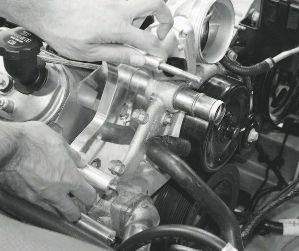 The next step involves mounting the rear portion of the supercharger support bracket. In most cases, it replaces the factory tensioner or idler pulley, although the location and placement varies among vehicles. The passengerside location on this Corvette is typical.